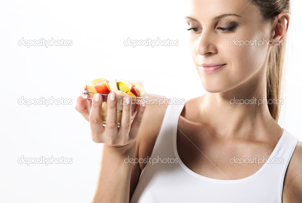 Fit young woman eating fruit salad — 图库照片 #8504058