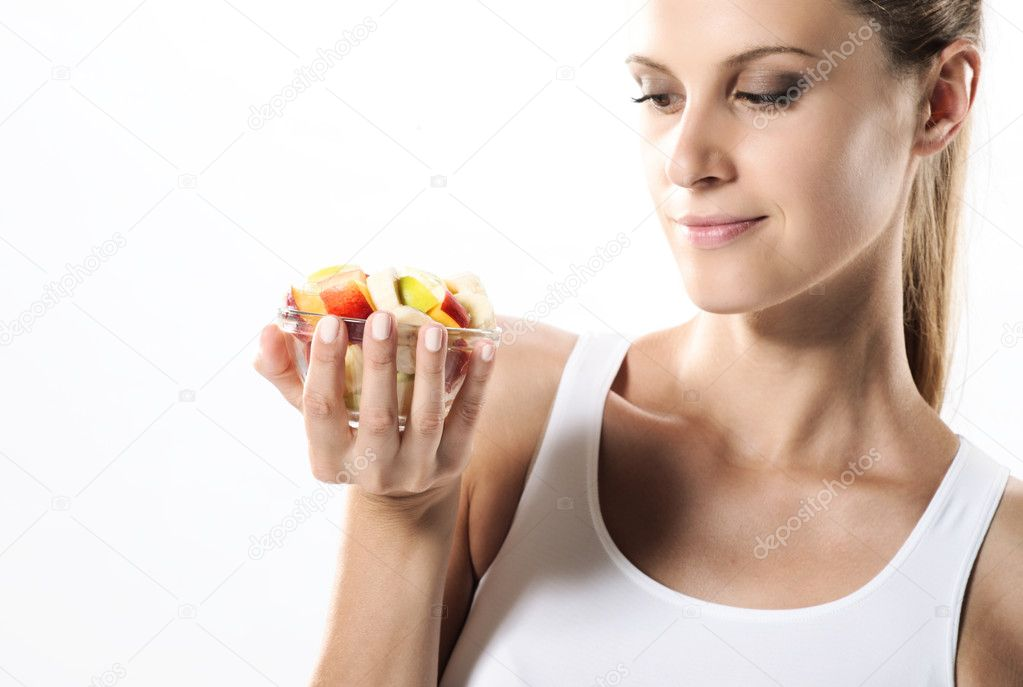 Fit young woman eating fruit salad — Lizenzfreies Foto #8504058