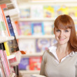 Royalty-Free Stock Photo: Smiling young college student in a library
