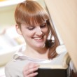 Portrait of a young student in a library — Stock Photo