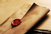 Wax seal on a grunge paper — 图库照片