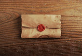Wax seal on a letter paper , background is wooden table — Stock Photo