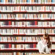 Young student in a library — Stock Photo #9031514