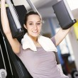 Young woman works out on weight-training machine — Stock Photo