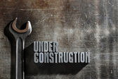 Image of a Under Construction sign with a metallic background te — Stock Photo