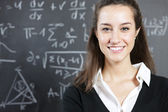 Portrait of a smiling young woman, college student or teacher in — Stock Photo