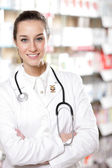 Portrait of smiling young woman pharmacist with stethoscope — Stock Photo