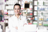 Portrait of young healthcare worker and background pharmacy. — Stock Photo