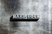 Metal HARD ROCK background : antique metal letter-press type. — Stock Photo