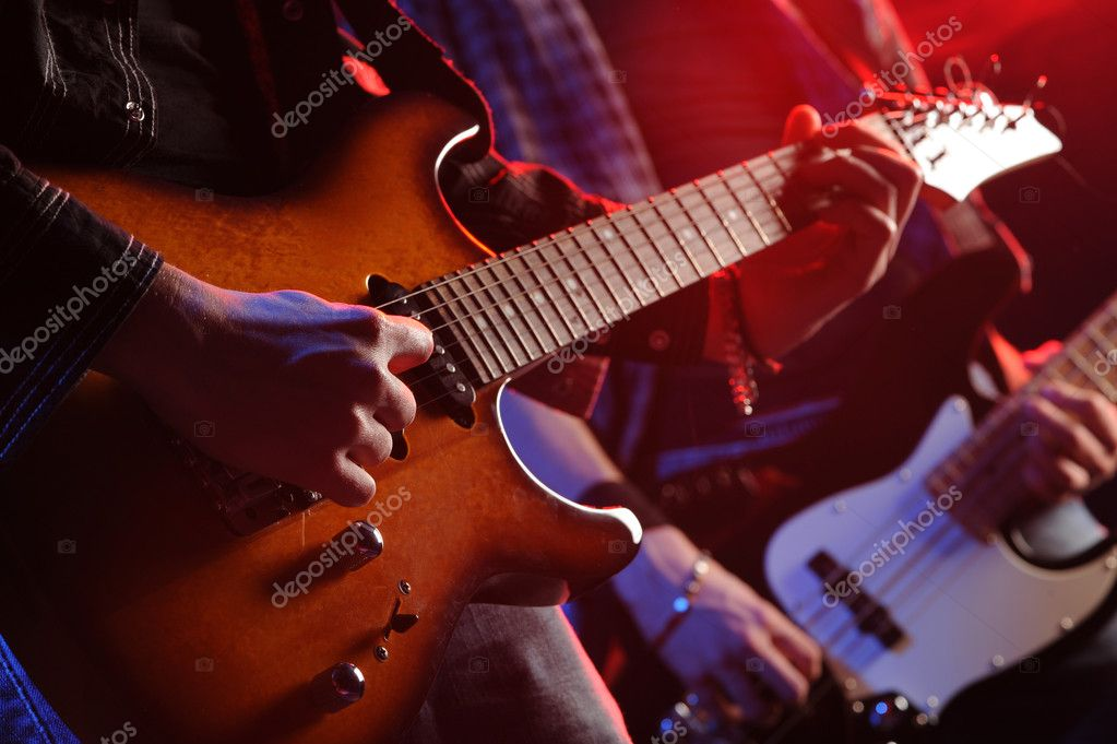 Rock musicians playing at a live concert  Stock Photo #9031735