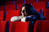Funny movie: portrait of a pretty girl in a movie theater, she l — Stock Photo