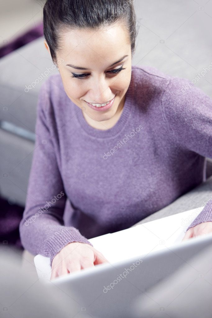 At home: young woman working on her laptop — Stock Photo #9193641