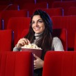 Funny movie: portrait of a pretty girl in an empty theater, she — Stock Photo