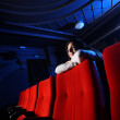 Portrait of a girl in a movie theater — Stock Photo #9290935