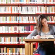 Portrait of a student girl studying at library — Stock Photo #9831125