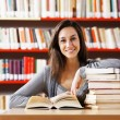 Portrait of a student  girl studying at library — Stock Photo