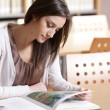 Young woman with book — Stock Photo