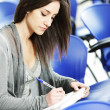 Young female is writing notes — Stock Photo