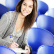 Young female is writing notes — Stockfoto #9833846