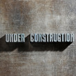 Image of a Under Construction sign with a metallic background te — Stock Photo #9882085