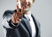 Young businessman hand showing the victory sign. — Stock fotografie