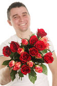 Man with roses — Stock Photo