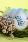 Colorful Easter eggs in an egg holder — Stock Photo