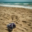 Stock Photo: Get your shoes off, we are in the beach!!