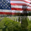 Stock Photo: Soldier silhouette, american flag and grave stones.