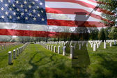 Soldier silhouette, american flag and grave stones. — Stock Photo