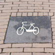 Foto Stock: Bicycle sign on Dutch brick road