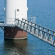 Footbridge for maintenance of a windmill standing in the sea; th — Стоковая фотография