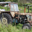 Old neglected tractor - Stock Photo