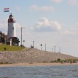 Seacoast with lighthouse of Urk, fishing village in the Netherla — Stock Photo