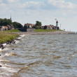 Seacoast with lighthouse - Stock Photo