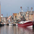 Stock fotografie: Traditional and modern fishing cutter in harbor of Urk, the