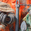 Stock fotografie: Big pile of fishing nets and anchor