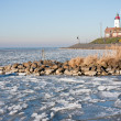 Foto Stock: Wintertime, skyline form island in frozen sea.
