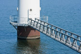 Footbridge for maintenance of a windmill standing in the sea; th — Stock Photo