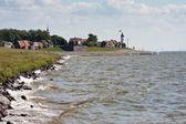 Seacoast with lighthouse — Stock Photo