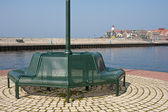 Green bench at the harbor of Urk in the Netherlands — Stock Photo