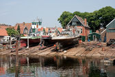 Old Dutch shipyard with tugboats — Stock Photo