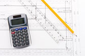Building plan with calculator, ruler and pencil — Stok fotoğraf