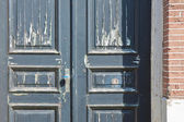 Old wooden door with chipping paint — Stock Photo