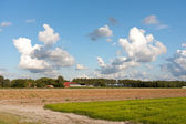 Farmland in the Netherlands with a typical Dutch cloudscape — Stock Photo