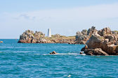 Rocky coast with landmark in Brittany, France — Stockfoto