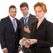 Female business woman is counting money with curious male collea — Stock Photo