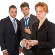 Female business woman is counting money with curious male collea - Stock Photo