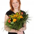 Young attractive woman with a bouquet of flowers - isolated on w — Stock Photo #8687481