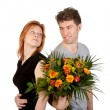 Man and woman in love with a beautiful bunch of flowers — Stock Photo #8740052